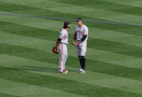 Angel Pagan and Hunter Pence having a serious talk in the OF on Saturday 9.21.13 at Yankee Stadium. Photo by Denise Walos.