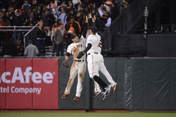 June 18, 2013; San Francisco, CA, USA; San Francisco Giants left fielder Gregor Blanco (7, left), right fielder Hunter Pence (8, center), and center fielder Juan Perez (2, right) celebrate after the game against the San Diego Padres at AT