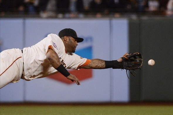 September 5, 2013; San Francisco, CA, USA; San Francisco Giants third baseman Pablo Sandoval (48) goes all out diving sideways for the ball, just as he goes all out in all of his endeavors.