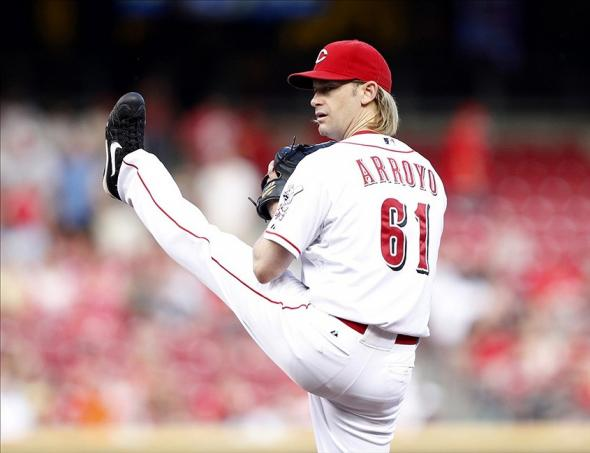 Aug 9, 2013; Cincinnati, OH, USA; Cincinnati Reds starting pitcher Bronson Arroyo (61) pitches during the first inning against the San Diego Padres at Great American Ball Park. Mandatory Credit: Frank Victores-USA TODAY Sports
