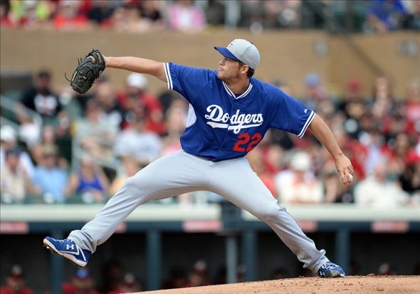 Feb 26, 2014; Salt River Pima-Maricopa, AZ, USA; Los Angeles Dodgers starting pitcher Clayton Kershaw (22), representing the face and the arm of the Los Angeles Dodgers. Mandatory Credit: Joe Camporeale-USA TODAY Sports