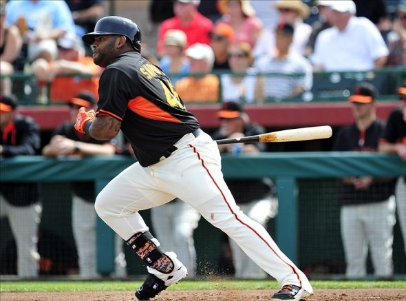 March 5, 2014; Scottsdale, AZ, USA; San Francisco Giants third baseman Pablo Sandoval (48) hits an RBI single in the first inning against the Los Angeles Angels at Scottsdale Stadium. Mandatory Credit: Gary A. Vasquez-USA TODAY Sports