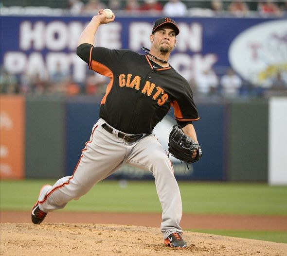 Mar 13, 2014; Surprise, AZ, USA; San Francisco Giants pitcher Ryan Vogelsong (32) throws during the first inning against the Texas Rangers at Surprise Stadium. Mandatory Credit: Christopher Hanewinckel-USA TODAY Sports