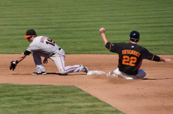 Christian Arroyo ties to tag Roger Kieschnick on a steal.
