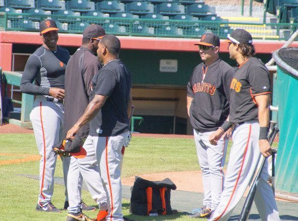 Bonds, Meulens, Sandoval, Aurilla, Morse discussing mechanics at BP on March 11, 2014. Photo by Denise Walos.