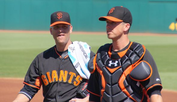Hudson and Posey chatting after warmups on March 11, 2014. Photo by Denise Walos.