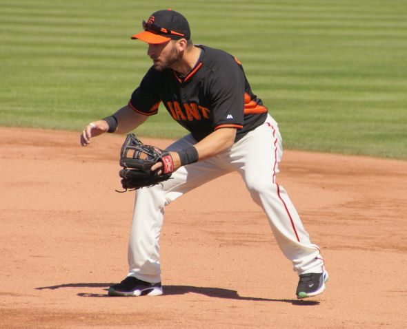 Scutaro taking ground balls at 2B during warmups on March 12, 2014. Photo by Denise Walos.