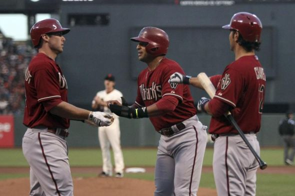 Gerardo Parra, Paul Goldschmidt, and Eric Chavez of the Arizona Diamondbacks