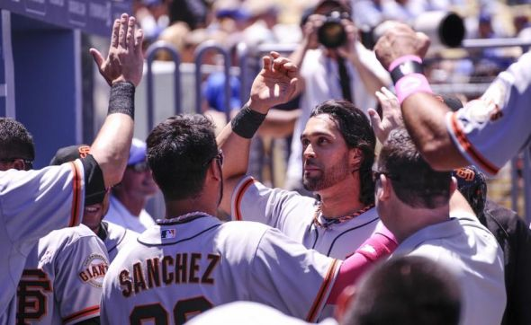 Angel Pagan of the San Francisco Giants is greeted by teammates.