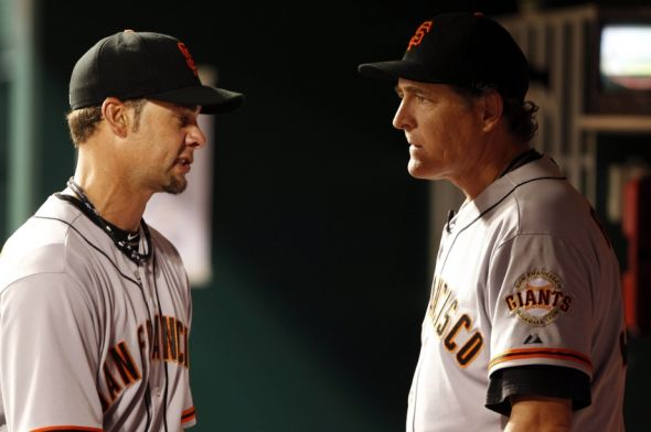 Dave Righetti confers with Ryan Vogelsong of the San Francisco Giants