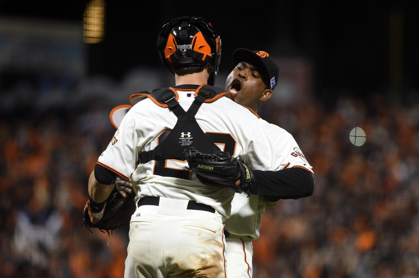 Santiago Casilla and Buster Posey of the San Francisco Giants