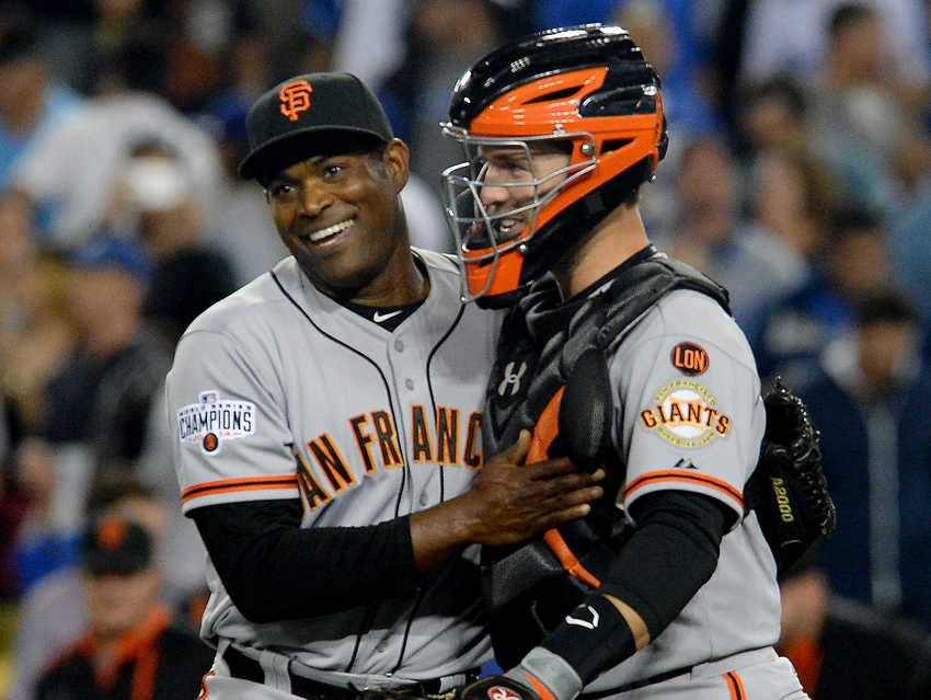 Apr 28, 2015; Los Angeles, CA, USA; San Francisco Giants relief pitcher Santiago Casilla (46) shakes hands with catcher Buster Posey (28) after the game against the Los Angeles Dodgers at Dodger Stadium. Giants won 2-1. Mandatory Credit: Jayne Kamin-Oncea-USA TODAY Sports