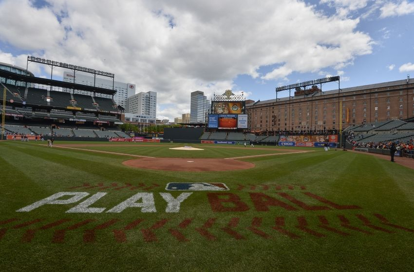 "May 15, 2016; Baltimore, MD, USA; A general view of the Major League Baseball ""Play Ball"" logo on the field before the start of the game between the Baltimore Orioles and the Detroit Tigers at Oriole Park at Camden Yards. Mandatory Credit: Tommy Gilligan-USA TODAY Sports"