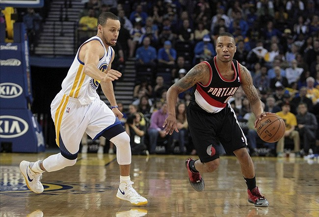 Mar 30, 2013; Oakland, CA, USA; Portland Trail Blazers point guard Damian Lillard (0) dribbles ahead of Golden State Warriors point guard Stephen Curry (30) during the first quarter at Oracle Arena. Mandatory Credit: Kelley L Cox-USA TODAY Sports