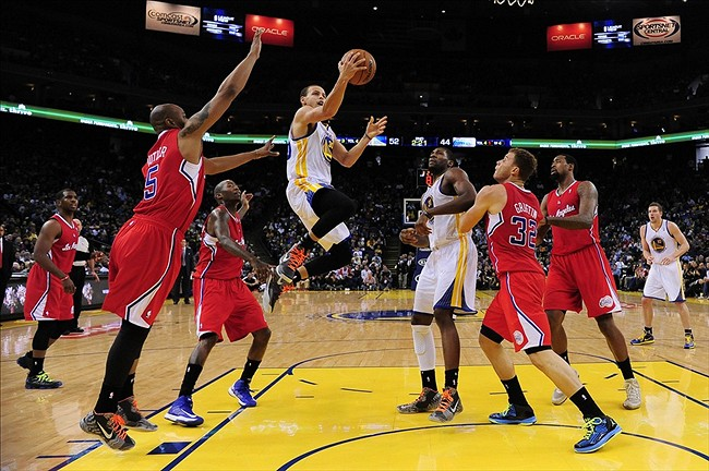 January 21, 2013; Oakland, CA, USA; Golden State Warriors point guard Stephen Curry (30) shoots the ball against the Los Angeles Clippers during the second quarter at Oracle Arena. The Warriors defeated the Clippers 106-99. Mandatory Credit: Kyle Terada-USA TODAY Sports