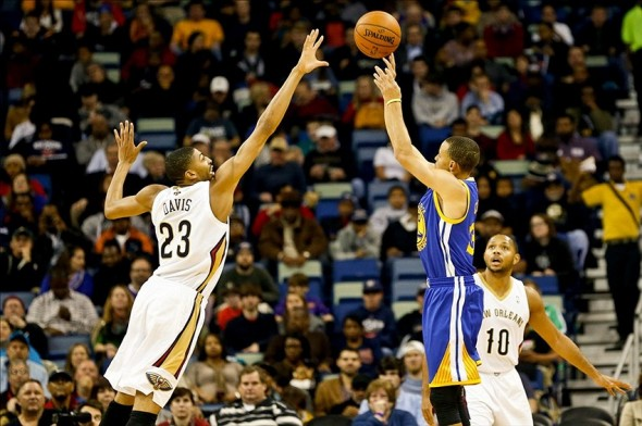 Nov 26, 2013; New Orleans, LA, USA; Golden State Warriors point guard Stephen Curry (30) shoots over New Orleans Pelicans power forward Anthony Davis (23) during the first quarter of a game at New Orleans Arena. Mandatory Credit: Derick E. Hingle-USA TODAY Sports
