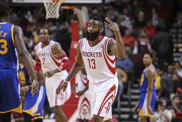 Dec 6, 2013; Houston, TX, USA; Houston Rockets shooting guard James Harden (13) reacts after making a basket during the fourth quarter against the Golden State Warriors at Toyota Center. The Rockets defeated the Warriors 105-83. Mandatory Credit: Troy Taormina-USA TODAY Sports