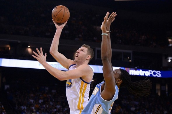 January 15, 2014; Oakland, CA, USA; Golden State Warriors power forward David Lee (10) shoots the ball against Denver Nuggets power forward Kenneth Faried (35) during the fourth quarter at Oracle Arena. The Nuggets defeated the Warriors 123-116. Mandatory Credit: Kyle Terada-USA TODAY Sports