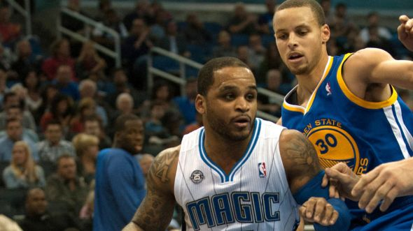 Dec 31, 2013; Orlando, FL, USA; Orlando Magic point guard Jameer Nelson (14) drives against Golden State Warriors point guard Stephen Curry (30) at Amway Center. Mandatory Credit: Jeff Griffith-USA TODAY Sports