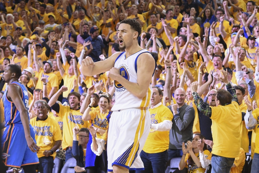 May 30, 2016; Oakland, CA, USA; Golden State Warriors guard Klay Thompson (11) celebrates after making a basket during the second quarter in game seven of the Western conference finals of the NBA Playoffs against the Oklahoma City Thunder at Oracle Arena. Mandatory Credit: Kyle Terada-USA TODAY Sports