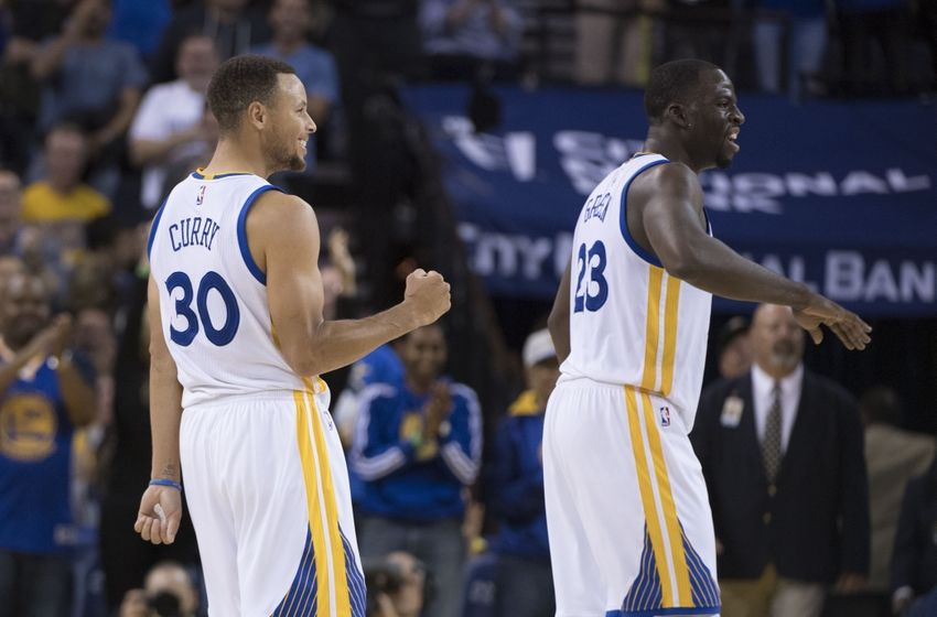November 7, 2016; Oakland, CA, USA; Golden State Warriors guard Stephen Curry (30) celebrates with forward Draymond Green (23) after Curry made his 13th three-point basket during the fourth quarter against the New Orleans Pelicans at Oracle Arena. Curry made 13-three point baskets for the NBA record of most three-pointers in a single game. The Warriors defeated the Pelicans 116-106. Mandatory Credit: Kyle Terada-USA TODAY Sports