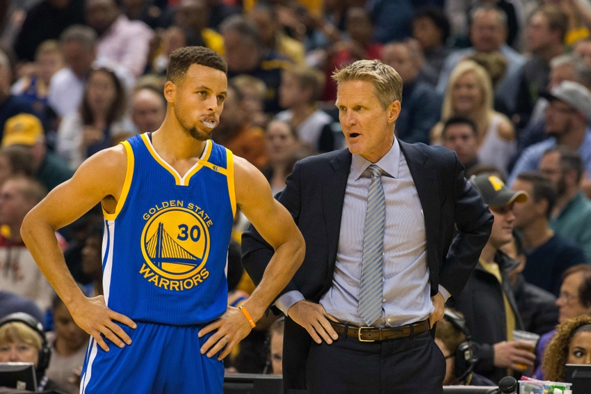 Nov 21, 2016; Indianapolis, IN, USA; Golden State Warriors guard Stephen Curry (30) and Warriors head coach Steve Kerr talk on the sideline in the first half of the game against the Indiana Pacers at Bankers Life Fieldhouse. Golden State beat Indiana 120-83. Mandatory Credit: Trevor Ruszkowski-USA TODAY Sports