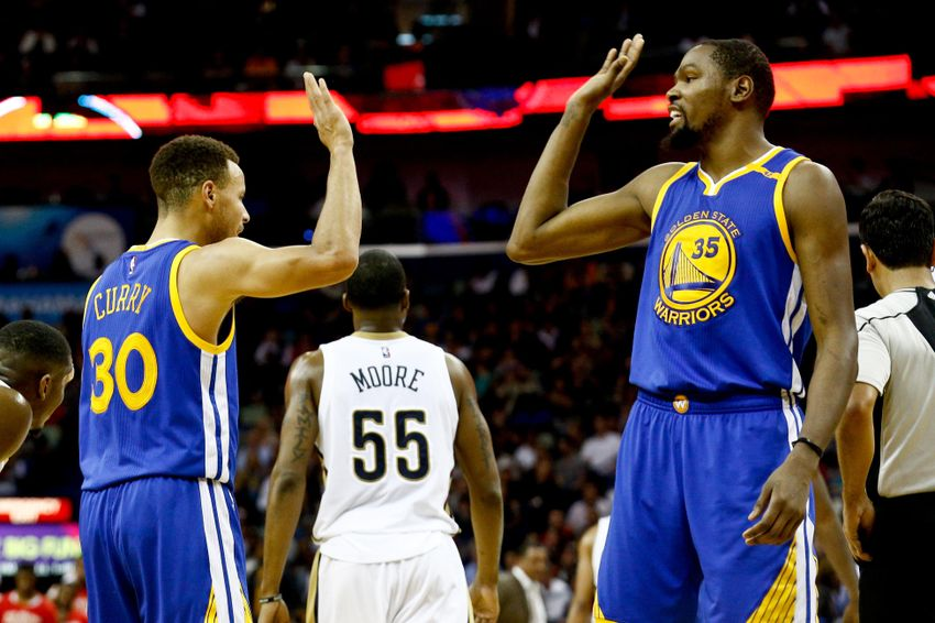 Curry, Warriors warm up and thump Utah Jazz 104-74