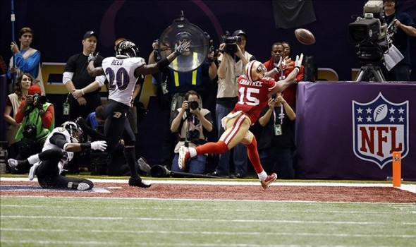 Feb 3, 2013; New Orleans, LA, USA; San Francisco 49ers wide receiver Michael Crabtree (15) is unable to catch a pass in the end zone while defended by Baltimore Ravens free safety Ed Reed (20) on a fourth down play in the fourth quarter in Super Bowl XLVII at the Mercedes-Benz Superdome. Mandatory Credit: Derick E. Hingle-USA TODAY Sports