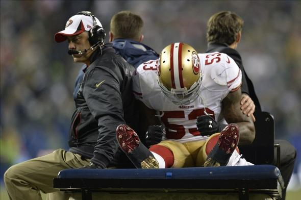 Jan 19, 2014; Seattle, WA, USA; San Francisco 49ers inside linebacker NaVorro Bowman (53) is carted off the field during the second half of the 2013 NFC Championship football game against the Seattle Seahawks at CenturyLink Field. The Seahawks defeated the 49ers 23-17. Mandatory Credit: Steven Bisig-USA TODAY Sports