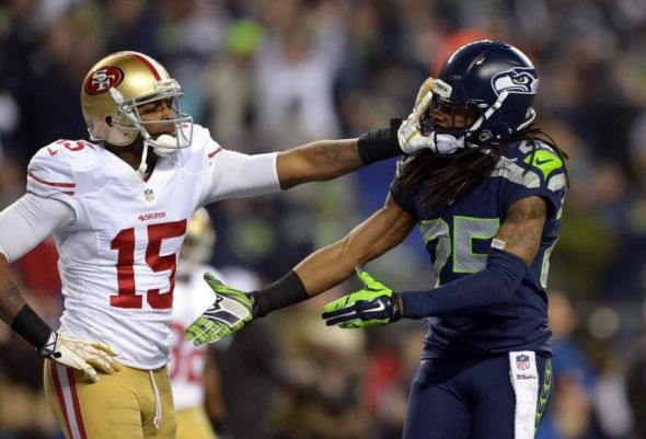 Michael Crabtre and Richard Sherman. Mandatory Credit: Kirby Lee-USA TODAY Sports