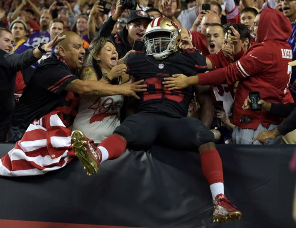 Sep 14, 2015; Santa Clara, CA, USA; San Francisco 49ers running back Carlos Hyde (28) celebrates with fans after scoring on a 10-yard touchdown run in the fourth quarter against the Minnesota Vikings at Levi's Stadium. Mandatory Credit: Kirby Lee-USA TODAY Sports