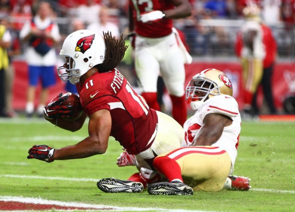 Sep 27, 2015; Glendale, AZ, USA; Arizona Cardinals wide receiver Larry Fitzgerald (11) dives into the end zone after catching a pass for a touchdown against the San Francisco 49ers at University of Phoenix Stadium. Mandatory Credit: Mark J. Rebilas-USA TODAY Sports