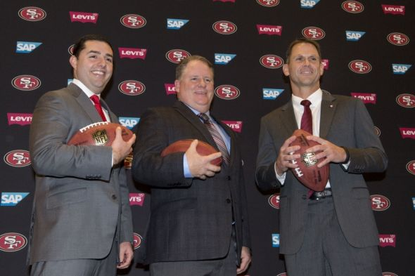 January 20, 2016; Santa Clara, CA, USA; San Francisco 49ers chief executive officer Jed York (left), Chip Kelly (center), and San Francisco 49ers general manager Trent Baalke (right) pose for a photo in a press conference after naming Kelly as the new head coach for the San Francisco 49ers at Levi's Stadium Auditorium. Mandatory Credit: Kyle Terada-USA TODAY Sports