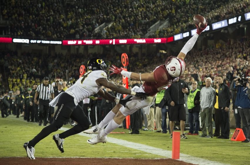 November 14, 2015; Stanford, CA, USA; Oregon Ducks cornerback Ugo Amadi (14, left) is called for defensive pass interference against Stanford Cardinal wide receiver Devon Cajuste (89, right) during the fourth quarter at Stanford Stadium. The Ducks defeated the Cardinal 38-36. Mandatory Credit: Kyle Terada-USA TODAY Sports