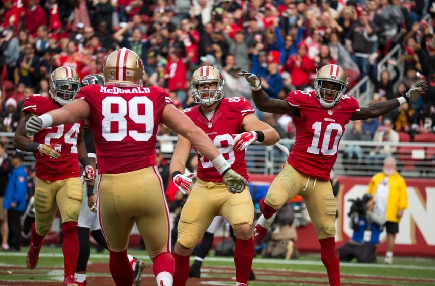 November 8, 2015; Santa Clara, CA, USA; San Francisco 49ers tight end Garrett Celek (88) is congratulated by tight end Vance McDonald (89) and wide receiver Bruce Ellington (10) for scoring a touchdown during the second quarter against the Atlanta Falcons at Levi Stadium. Mandatory Credit: USA Today Sports