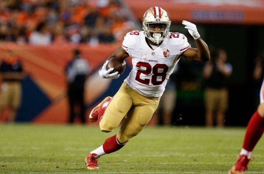 Aug 20, 2016; Denver, CO, USA; San Francisco 49ers running back Carlos Hyde (28) runs the ball for a first down in the second quarter against the Denver Broncos at Sports Authority Field at Mile High. Mandatory Credit: Isaiah J. Downing-USA TODAY Sports