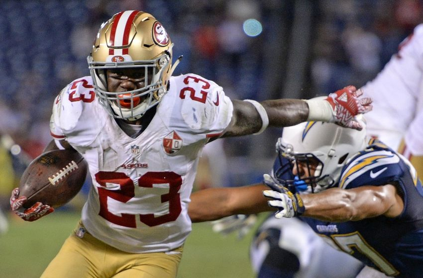 Sep 1, 2016; San Diego, CA, USA; San Francisco 49ers running back Kelvin Taylor (23) runs for a touchdown as San Diego Chargers running back Kenneth Farrow (27) defends during the fourth quarter at Qualcomm Stadium. Mandatory Credit: Jake Roth-USA TODAY Sports