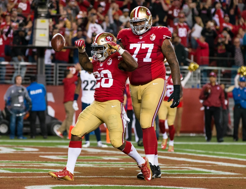 Sep 12, 2016; Santa Clara, CA, USA; San Francisco 49ers running back Carlos Hyde (28) celebrates after he scores a touchdown against the Los Angeles Rams in the fourth quarter at Levi's Stadium. The 49ers won 28-0. Mandatory Credit: John Hefti-USA TODAY Sports
