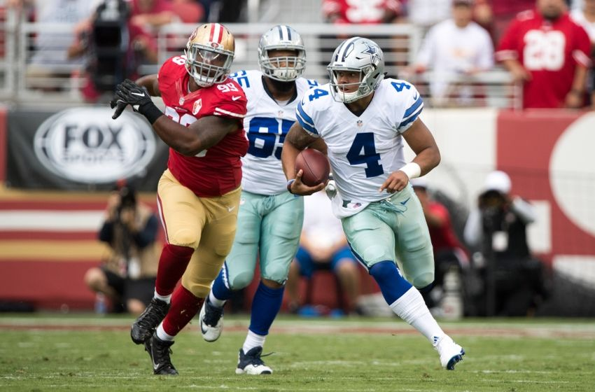 October 2, 2016; Santa Clara, CA, USA; Dallas Cowboys quarterback Dak Prescott (4) runs with the football against San Francisco 49ers defensive lineman DeForest Buckner (99) during the first quarter at Levi's Stadium. Mandatory Credit: Kyle Terada-USA TODAY Sports