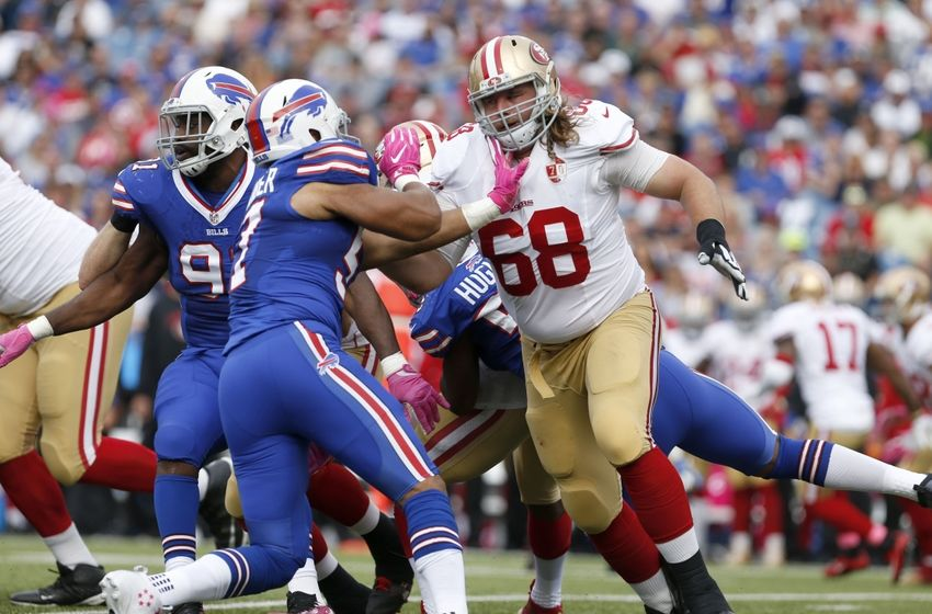 Oct 16, 2016; Orchard Park, NY, USA; San Francisco 49ers guard Zane Beadles (68) blocks Buffalo Bills linebacker Lorenzo Alexander (57) during the first half at New Era Field. Mandatory Credit: Timothy T. Ludwig-USA TODAY Sports