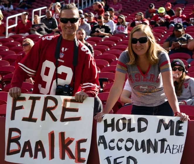 Nov 6, 2016; Santa Clara, CA, USA; San Francisco 49ers fans hold signs referencing general manager Trent Baalke and CEO Jed York before the game against the New Orleans Saints at Levi's Stadium. Mandatory Credit: Kelley L Cox-USA TODAY Sports