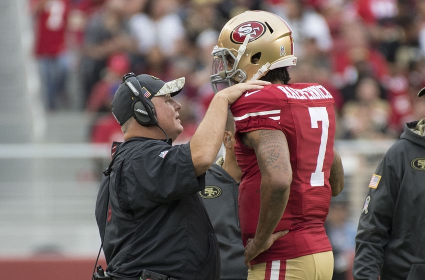 November 6, 2016; Santa Clara, CA, USA; San Francisco 49ers head coach Chip Kelly (left) talks to quarterback Colin Kaepernick (7) during the third quarter against the New Orleans Saints at Levi's Stadium. The Saints defeated the 49ers 41-23. Mandatory Credit: Kyle Terada-USA TODAY Sports