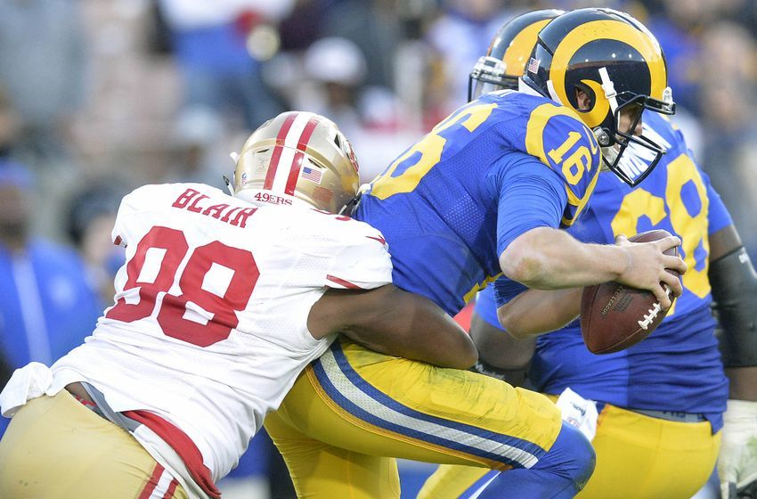 December 24, 2016; Los Angeles, CA, USA; Los Angeles Rams quarterback Jared Goff (16) is brought down by San Francisco 49ers defensive end Ronald Blair (98) during the second half at Los Angeles Memorial Coliseum. Mandatory Credit: Gary A. Vasquez-USA TODAY Sports