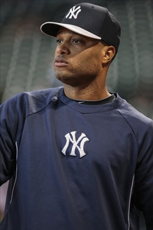 Sep 28, 2013; Houston, TX, USA; New York Yankees second baseman Robinson Cano (24) warms up before a game against the Houston Astros at Minute Maid Park. Mandatory Credit: Troy Taormina-USA TODAY Sports