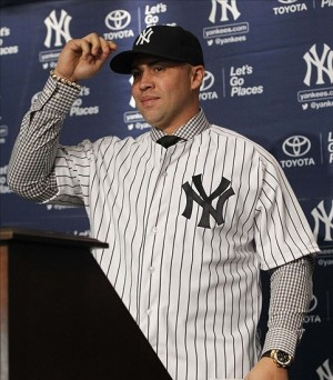 Dec 20, 2013; Bronx, NY, USA; New York Yankees new outfielder Carlos Beltran tips his cap during a introductory press conference at Yankees Stadium. Mandatory Credit: Noah K. Murray-USA TODAY Sports