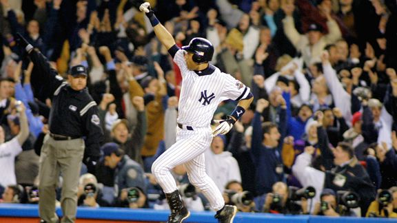 Derek Jeter circles the bases after hitting a walk-off home run during the 2001 World Series. (Photo courtesy of Al Bello/AP Images