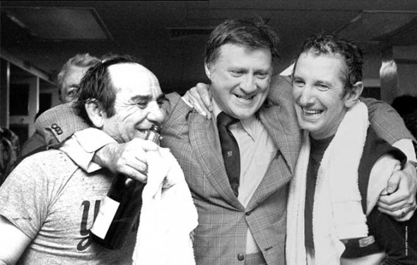 Billy Martin celebrates the 1977 Yankees World Series victory with Yankees owner George Steinbrenner and coach Yogi Berra.