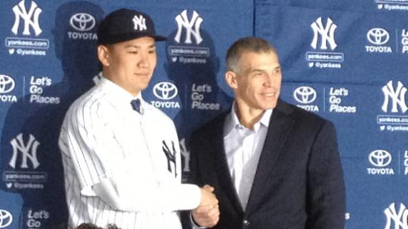 Masahiro Tanaka is introduced to the American media Tuesday. With him is Yankees manager Joe Girardi. Mandatory Credit: Juliet Papa/1010 WINS