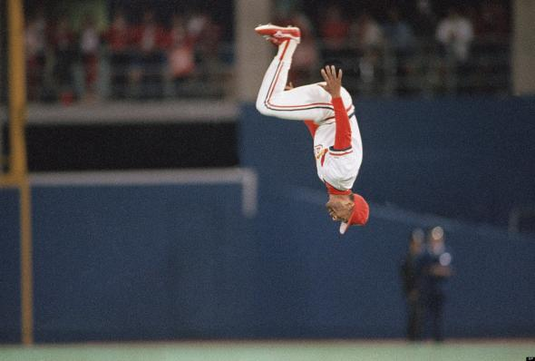 Ozzie Smith doing his famous back flip before the start of a game. Mandatory Credit: John Swart/AP