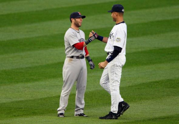 Red Sox second baseman Dustin Pedroia with Yankees captain Derek Jeter. Mandatory Credit: Jim McIsaac/Getty Images